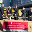 Stony Brook, NY; Stony Brook University Hospital: Stony Brook University broke ground to build a $194 million Medical and Research Translation (MART) Building as part of a $432M expansion of the Stony Brook Medicine campus. Scheduled to be complete in 2016, the MART will allow scientists and physicians to work side by side to research and discover new treatments and technology. The 245,000-square-foot, 8-story MART will include research laboratories, a conference center and educational space. Furthermore, it will create 1,200 construction jobs and several hundred new specialized research jobs for the area.This expansion is made possible by New York State Governor Andrew M. Cuomo and the State University of New York under the leadership of Chancellor Nancy L. Zimpher through $35 million NYSUNY 2020 Challenge Grant, and $50 million in support through the historic $150 million gift from Jim and Marilyn Simons.Kevin Law, President and CEO of the Long Island Association, Jim Simons, President, Euclidean Capital, Founder and Board Chair of Renaissance Technologies LLC and former Chair of the Department of Mathematics at Stony Brook University, Governor Andrew Cuomo, SUNY Chancellor Nancy Zimpher, and Samuel L. Stanley Jr., MD, President, Stony Brook University